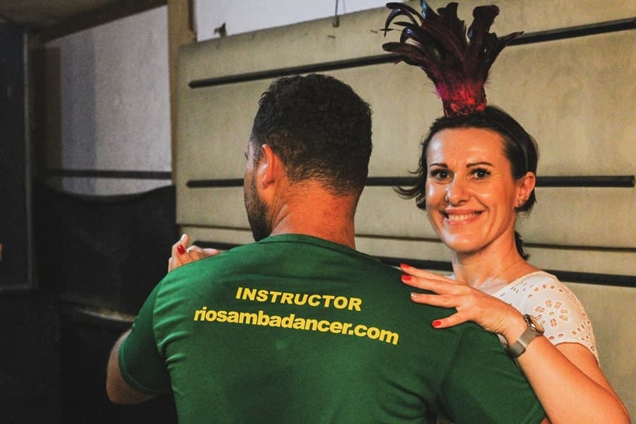 Studant with her samba instructor