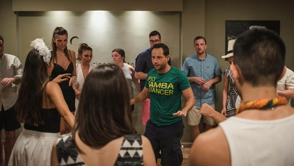 Our samba instructor Helio teaching how to shake